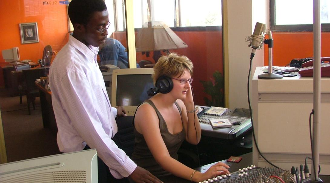 A local journalist and a Projects Abroad volunteer edit a story during her journalism internship in Ghana.